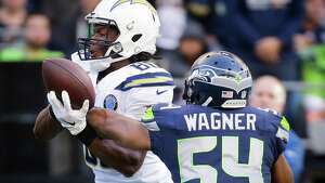Seahawks linebacker Bobby Wagner (54) breaks up a pass intended for Chargers tight end Sean Culkin in the second half of Seattle's game against the LA Chargers, Sunday, Nov. 4, 2018 at CenturyLink Field.