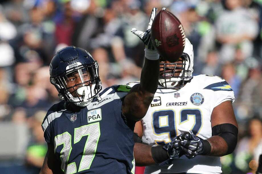 Seahawks running back Mike Davis celebrates a run in the first half of the Seahawks game against the LA Chargers, Sunday, Nov. 4, 2018 at CenturyLink Field. Photo: GENNA MARTIN, SEATTLEPI.COM / SEATTLEPI.COM