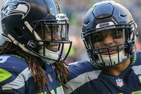 Seahawks linebacker Shaquem Griffin, left, and linebacker Austin Calitro celebrate in the first half of the Seahawks game against the LA Chargers, Sunday, Nov. 4, 2018 at CenturyLink Field.