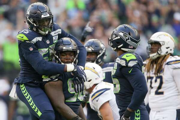 Seahawks defensive lineman Frank Clark (55) celebrates with defensive lineman Jarran Reed (90) after Reed's sack of Phillip Rivers in the fourth quarter of the Seahawks game against the LA Chargers, Sunday, Nov. 4, 2018 at CenturyLink Field.