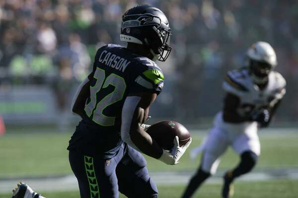 Seahawks running back Chris Carson runs the ball in the first half of the Seahawks game against the LA Chargers, Sunday, Nov. 4, 2018 at CenturyLink Field.