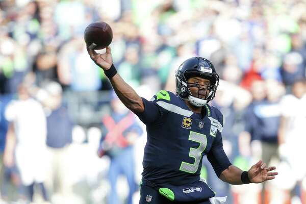 Seahawks quarterback Russell Wilson throws downfield in the first half of the Seahawks game against the LA Chargers, Sunday, Nov. 4, 2018 at CenturyLink Field.