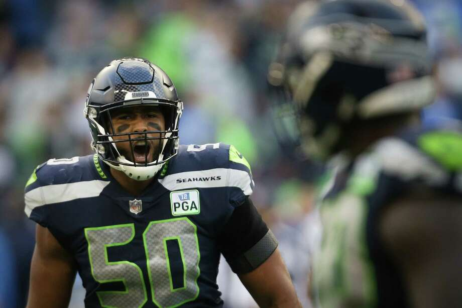 Seahawks linebacker K.J. Wright celebrates defensive lineman Jarran Reed's sack of Phillip Rivers in the fourth quarter of the Seahawks game against the LA Chargers, Sunday, Nov. 4, 2018 at CenturyLink Field. Photo: GENNA MARTIN, SEATTLEPI.COM / SEATTLEPI.COM