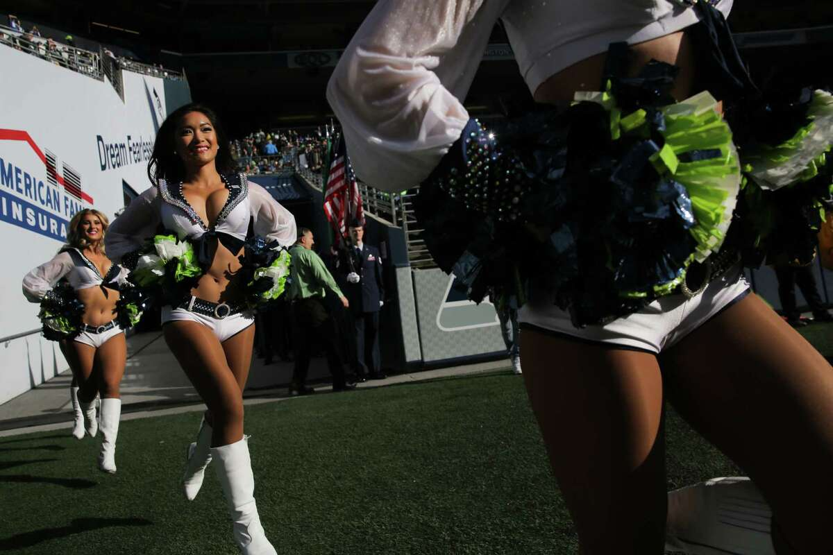 The SeaGals take the field before the Seahawks game against the LA Chargers, Sunday, Nov. 4, 2018 at CenturyLink Field.