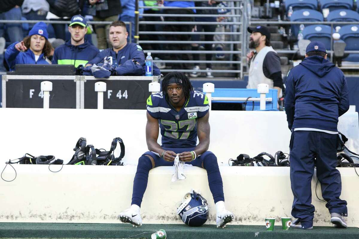 Seahawks corner back Tre Flowers sits on the bench after the Seahawks lost 25-17 to the LA Chargers, Sunday, Nov. 4, 2018 at CenturyLink Field.