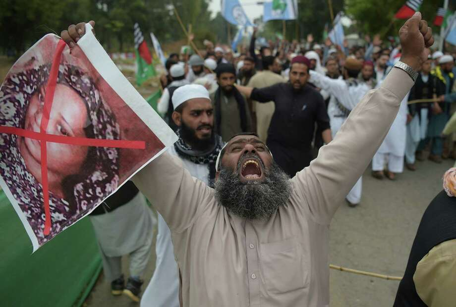 A Pakistani supporter of the Ahle Sunnat Wal Jamaat (ASWJ), a hardline religious party, holds an image of Christian woman Asia Bibi during a protest rally following the Supreme Court's decision to acquit Bibi of blasphemy, in Islamabad on November 2, 2018. - Pakistan's powerful military warned November 2 its patience had been thoroughly tested after being threatened by Islamist hardliners enraged by the acquittal of a Christian woman for blasphemy, as the country braced for more mass protests. (Photo by AAMIR QURESHI / AFP)AAMIR QURESHI/AFP/Getty Images Photo: AAMIR QURESHI / AFP or licensors