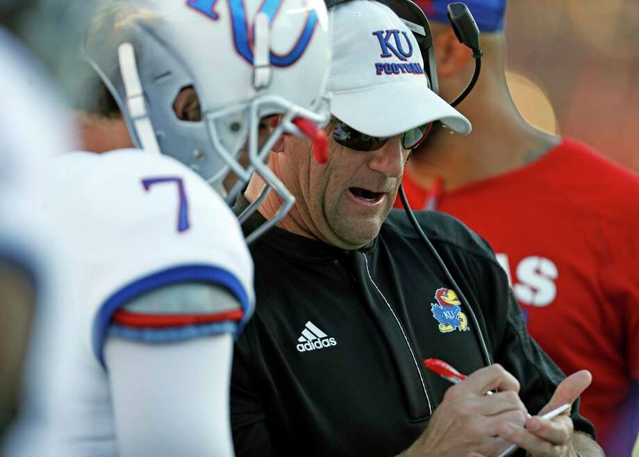 Kansas coach David Beaty talks to Peyton Bender (7) during the second half of an NCAA college football game against Texas Tech, Saturday, Oct. 20, 2018, in Lubbock, Texas. (Brad Tollefson/Lubbock Avalanche-Journal via AP) Photo: Brad Tollefson, Associated Press / Lubbock Avalanche-Journal
