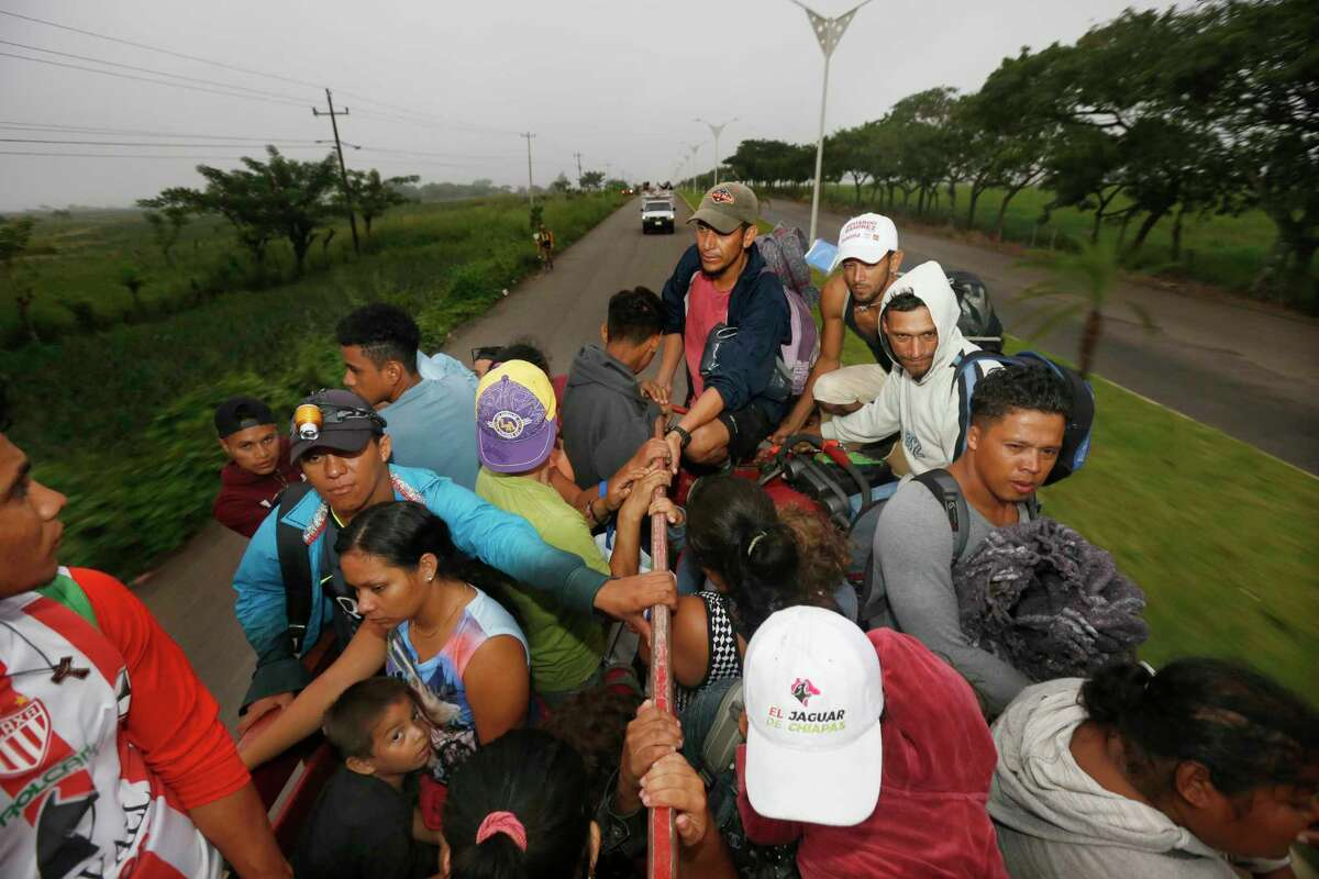 Central American migrants begin their morning trek as part of a thousands-strong caravan hoping to reach the U.S. border, as they move away from Isla, Veracruz state, Mexico, Sunday, Nov. 4, 2018. Thousands of wary Central American migrants resumed their push toward the United States on Sunday, a day after arguments over the path ahead saw some travelers splinter away from the main caravan, which is entering a treacherous part of its journey through Mexico. (AP Photo/Marco Ugarte)