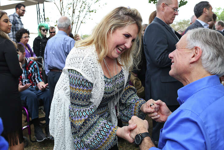 Shooting survivor Julie Workman talks with Governor Greg Abbott during Remembering Sutherland Springs: One Year Later at First Baptist Church of Sutherland Springs on Sunday, Nov. 4, 2018.