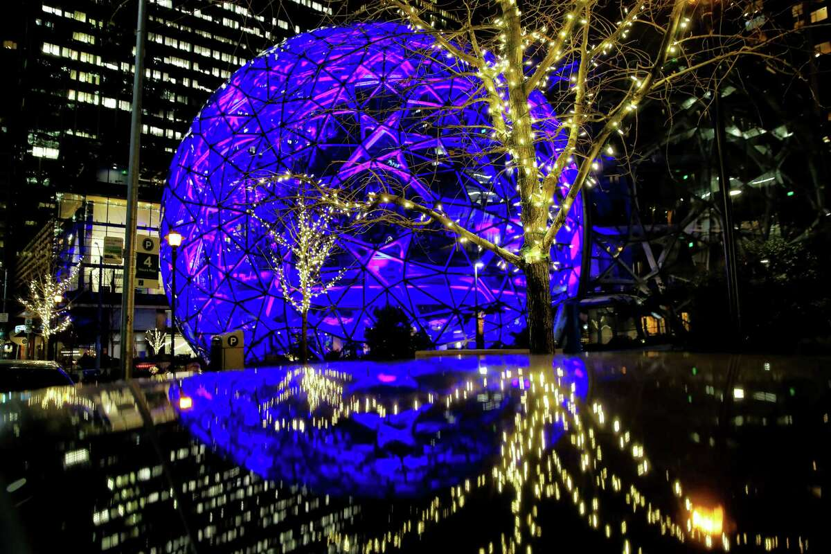 Buildings across Seattle and Bellevue, including the Amazon Spheres, are lit up in blue Sunday night in honor of Microsoft co-founder and Seahawks owner Paul Allen, who died on Oct. 15, Nov. 4, 2018.