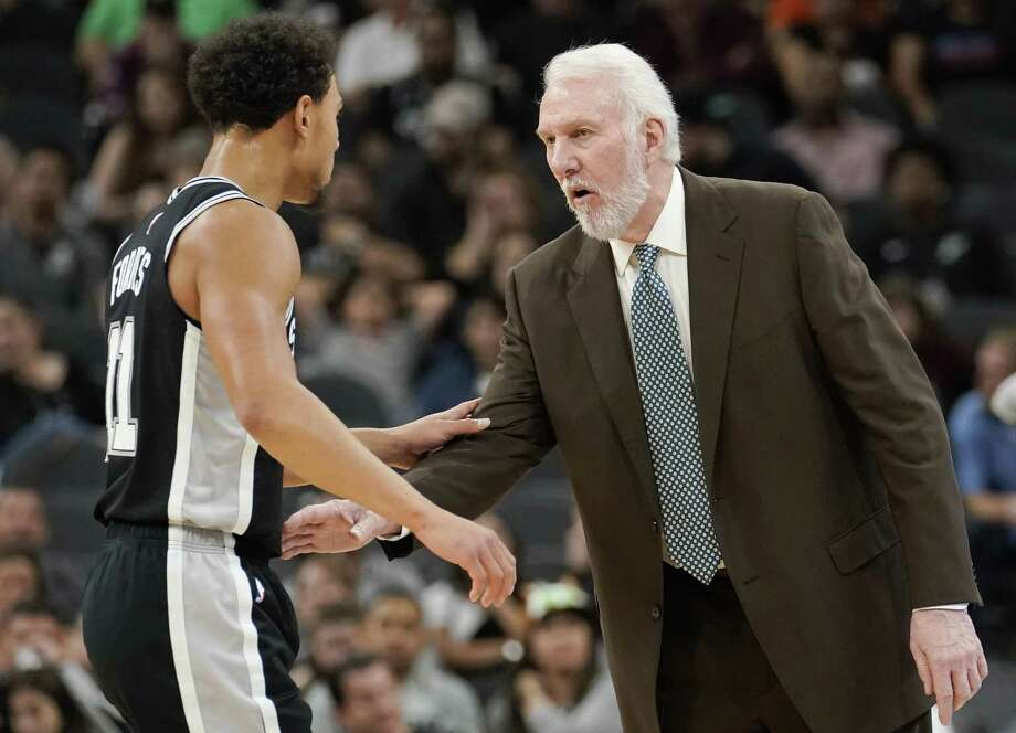 San Antonio Spurs head coach Gregg Popovich, right, talks to Spurs guard Bryn Forbes during the second half of an NBA basketball game against the Orlando Magic, Sunday, Nov. 4, 2018, in San Antonio. Orlando won 117-110. (AP Photo/Darren Abate) Photo: Darren Abate, FRE / Associated Press / FR115 AP
