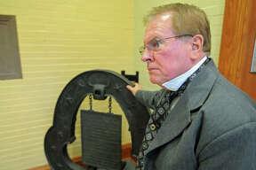 Elijah P. Lovejoy reenactor John Meehan poses by the original Lovejoy press.