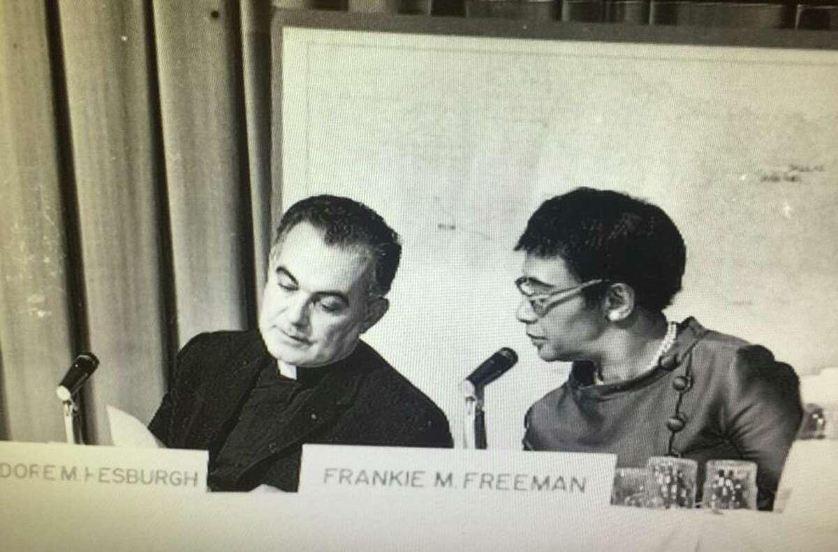 U.S. Commission on Civil Rights members Rev. Theodore Hesburgh (left) and Frankie Freeman confer during a commission hearing in December 1968 at Our Lady of the Lake College (as it was then known) in San Antonio. Hesburgh served on the commission from 1957, when it was created, to 1972. Freeman, a civil rights attorney, was the first woman appointed to the commission.The commission held hearings Dec. 9-14, 1968, at OLLU to gather information about the civil rights concerns of Mexican Americans in the five southwestern states.