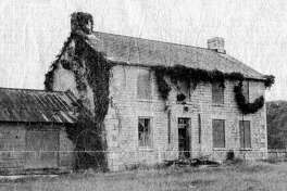 The old limestone home of the Samuel Gates family stands abandoned in an Illinois River valley field north of Eldred in Greene County.
