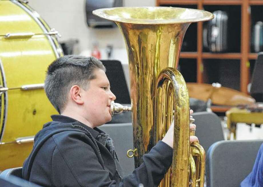 Eighth-grader Lyden Large practices the tuba at Jacksonville Middle School. Photo: Samantha McDaniel-Ogletree | Journal-Courier