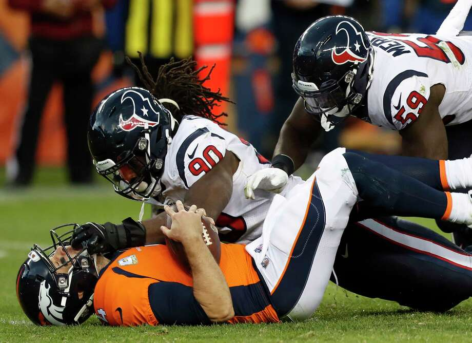 Houston Texans outside linebackers Jadeveon Clowney (90) and Whitney Mercilus (59) sack Denver Broncos quarterback Case Keenum (4) during the fourth quarter of an NFL football game at Broncos Stadium at Mile High on Sunday, Nov. 4, 2018, in Denver. Photo: Brett Coomer, Staff Photographer / © 2018 Houston Chronicle