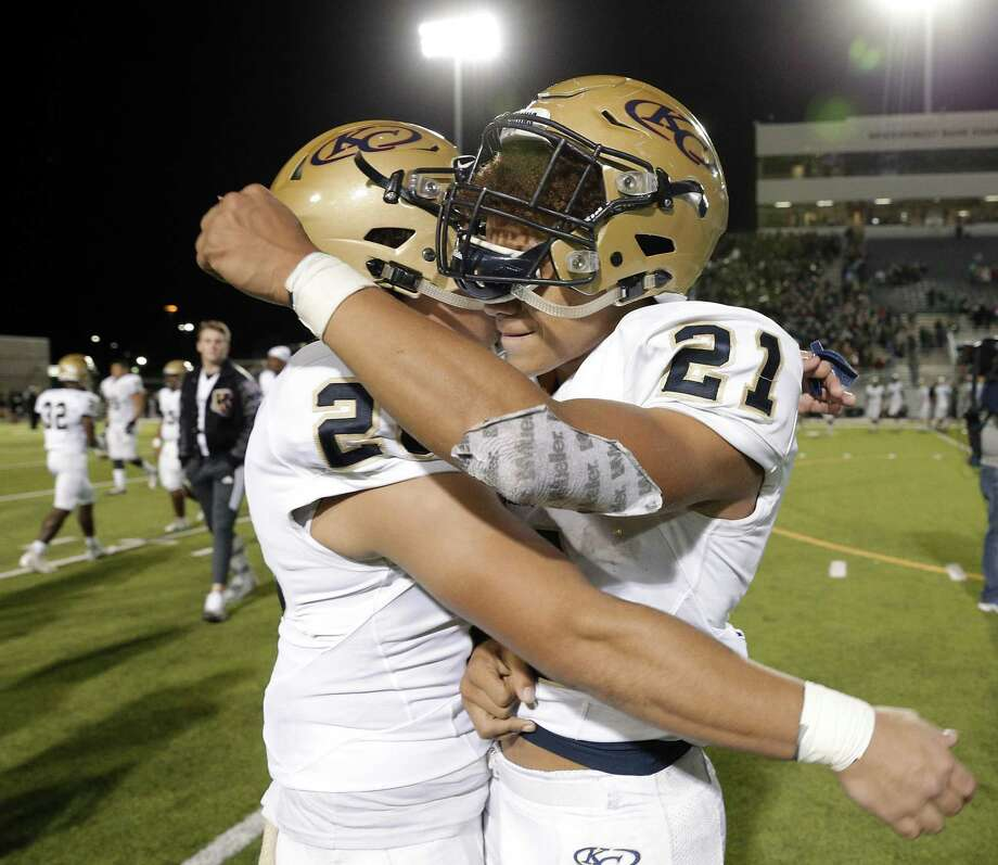 Klein Collins' John Madison (26) and Braelon Bridges (21) celebrate their 21-17 win over The Woodlands after the second half of their game Friday, Nov. 2, 2018 at Woodforest Bank Stadium in The Woodlands, TX. Photo: Michael Wyke, Houston Chronicle / Contributor / © 2018 Houston Chronicle