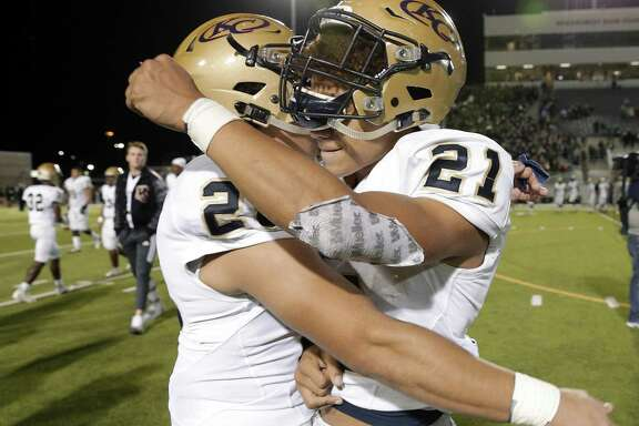 Klein Collins' John Madison (26) and Braelon Bridges (21) celebrate their 21-17 win over The Woodlands after the second half of their game Friday, Nov. 2, 2018 at Woodforest Bank Stadium in The Woodlands, TX.