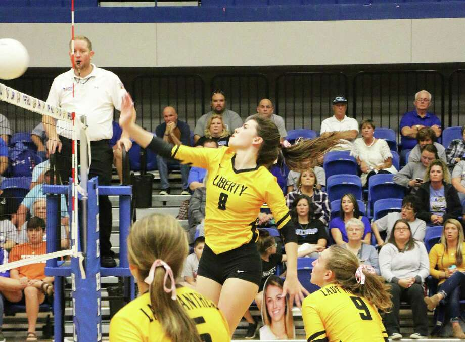 Jessica Williamson spikes the ball during the Liberty match against Hamshire-Fannett in the bi-district round of the state volleyball playoffs. Photo: David Taylor / HCN