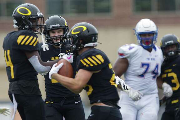 Klein Oak outside linebacker Nathan Herrscher, center, reacts after outside linebacker Dayton Capps (25) intercepted a pass intended for Oak Ridge wide receiver Adrian Murdaugh during the third quarter of a District 15-6A high school football game at Klein Memorial Stadium, Saturday, Oct. 20, 2018, in Spring.