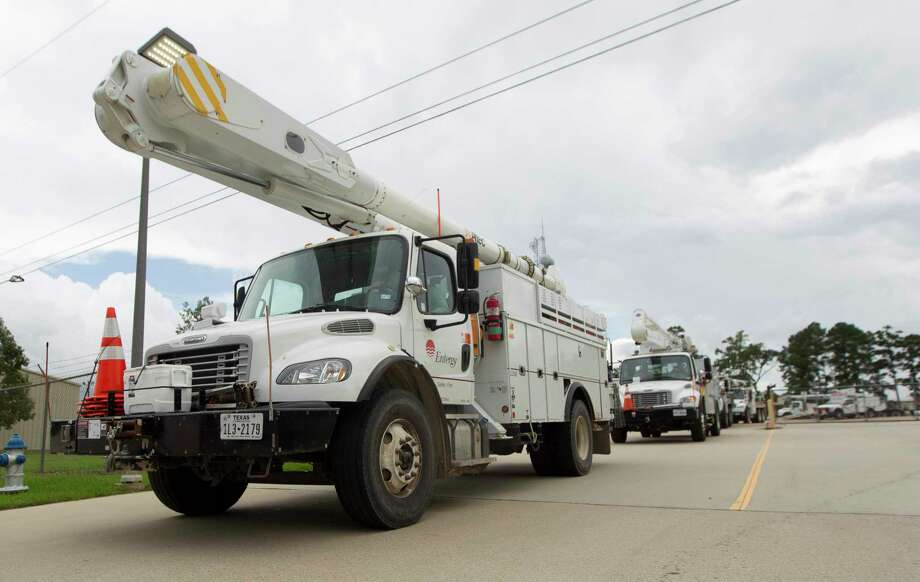 A lengthy power outage to Entergy Texas customers in The Woodlands on Tuesday, May 28, is being investigated by company officials after two employees suffered burn-like injuries, causing one to remain hospitalized on Wednesday. Kacee Kirschvink, a senior communications specialist with Entergy Texas, said as of 12:15 p.m., Wednesday, one worker remained hospitalized at an undisclosed medical facility while the other worker was treated in released. Photo: Jason Fochtman / Houston Chronicle