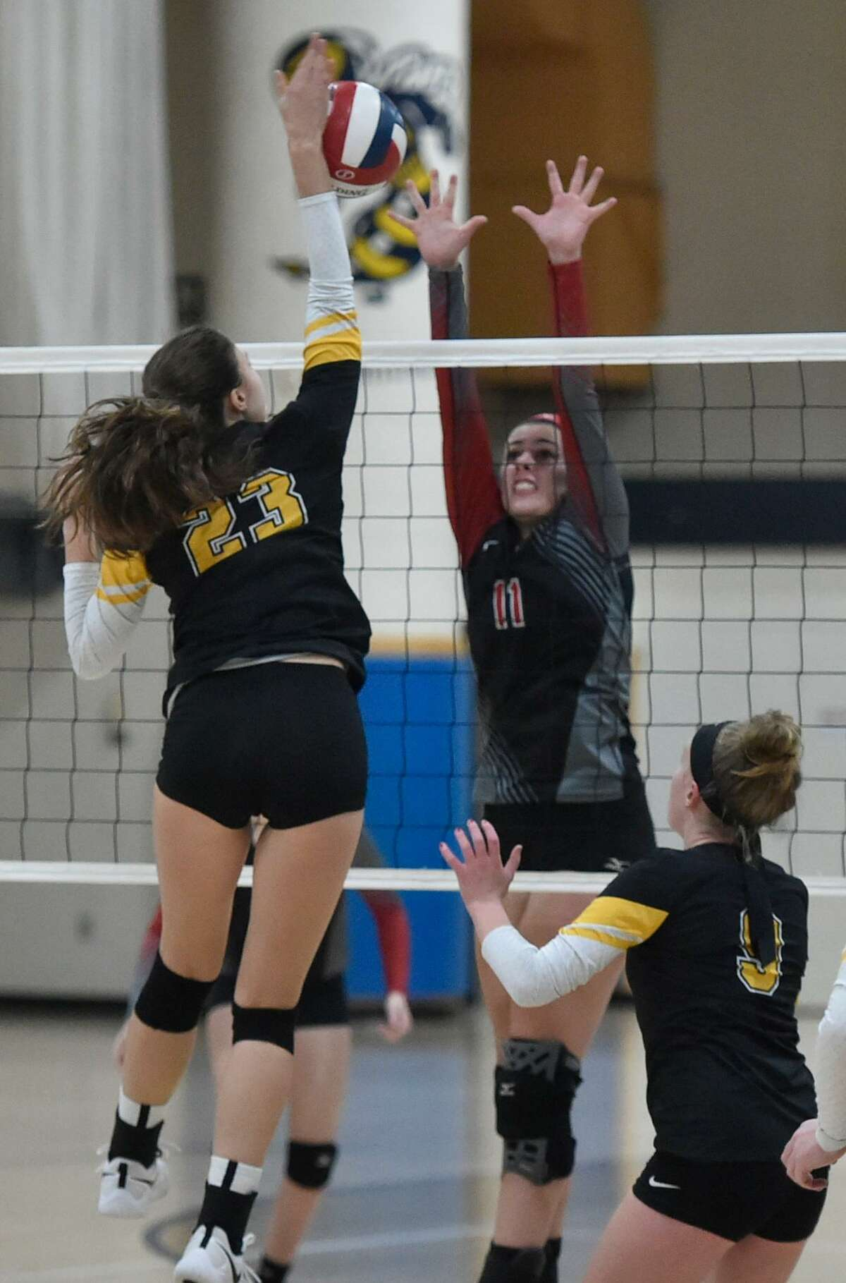 """East Haven, Connecticut - Saturday, November 3, 2018: #1 Cheshire H.S. vs. #2 Amity H.S. during the first game of the SCC Girls Volleyball """"Championship Final Saturday at East Haven H.S."""