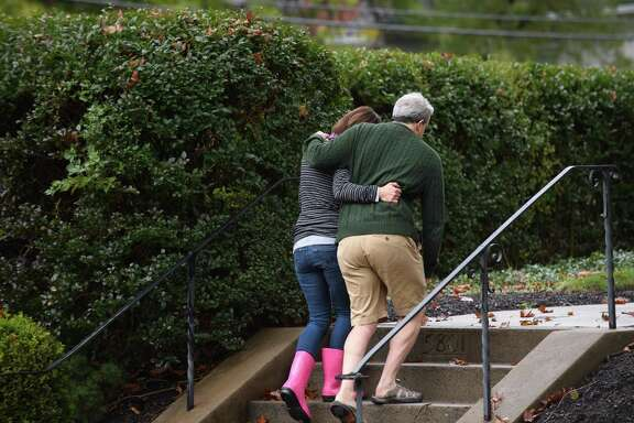 """Neighbors embrace near the site of a mass shooting at the Tree of Life Synagogue in Pittsburgh. In the wake of the tragedy, David Hirsch, president of the Shaar Hashalon congregation in Clear Lake, said people should stand against hate and racism. """"This is the time for good people to stand up and say 'Enough!'"""" he said. """"It's OK in our society for us to have civil differences, but when we get to the point where we teeter on the edge of allowing (racism and hate) to creep back in, then it's time for people of good conscience to stand up, no matter your politics or your faith."""""""