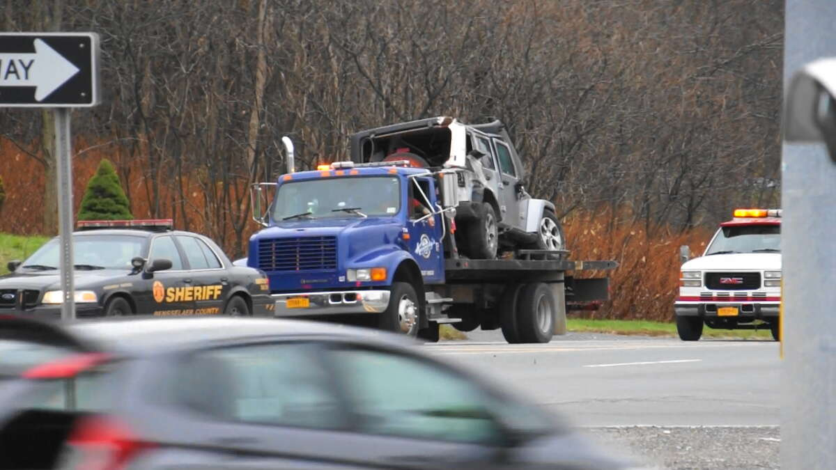 A Jeep involved in a fatal crash Monday morning in Schodack is taken away from the scene.