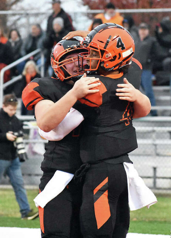 Edwardsville center Blake Moss, left, congratulates quarterback Kendall Abdur-Rahman after a touchdown in the second quarter against West Aurora on Saturday inside the District 7 Sports Complex. Photo: Matt Kamp/Intelligencer
