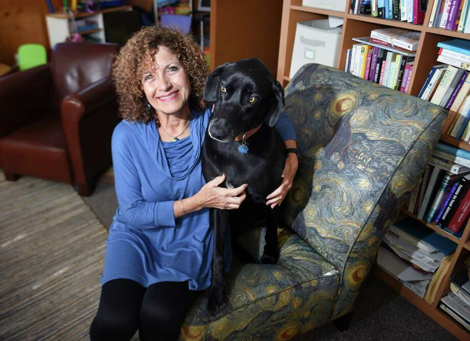 Loren Sterman, a licensed clinical social worker in Guilford is photographed in her office with her therapy dog, Lucie, on Oct. 12. Sterman believes children need to be taught to be more resilient and self-confident when it comes tto school bullying. Photo: Arnold Gold / Hearst Connecticut Media / New Haven Register