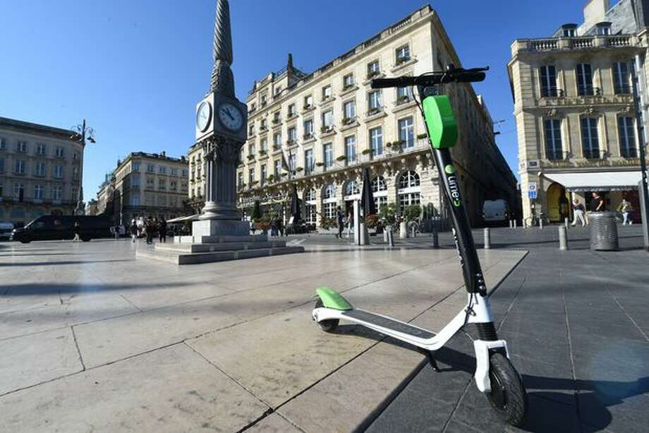 Lime's electronic scooters are popping up in cities across the world. Photo: Mehdi Fedouach/AFP/Getty Images