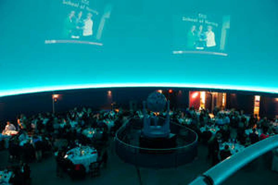The James S. McDonnell (JSM) Planetarium in St. Louis's Forest Park showcased SIUE red as it hosted the School of Nursing's Biennial Alumni and Friends Celebration. Photo: For The Telegraph