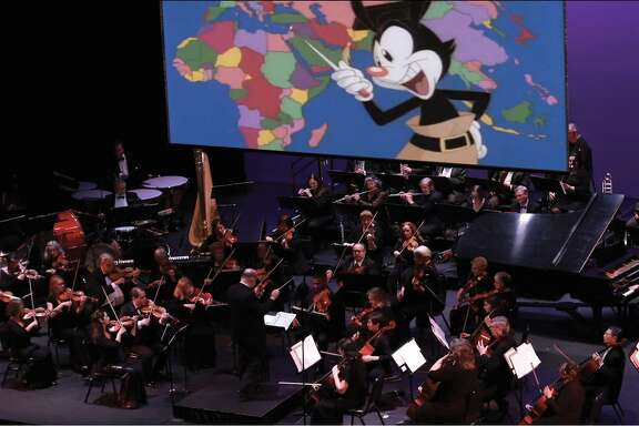 An orchestra performs music to the TV show the Animaniacs at the first Animaniacs Live show in La Mirada, Calif.