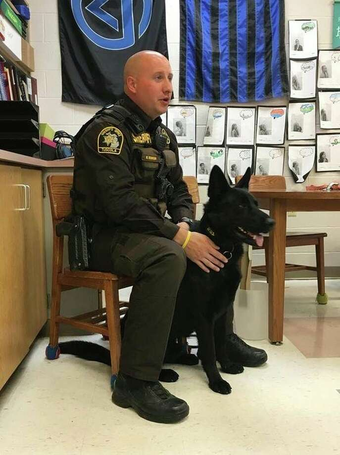 Tuscola County Deputy Ryan Robinson and his partner, Blek, a Dutch Shepard, did a safety presentation to Cass City School District students. While the students learned about safety, the canine worked on his socialization skills. (Submitted Photo)