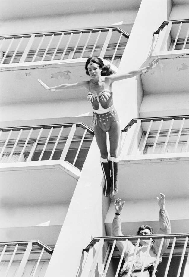 Stunt woman Kitty O'Neil's face mirrors the strain of stunt she is performing for the TV show Wonderwoman. The script calls for Wonderwoman to jump from a 12 story building and Kitty was called in to do the jump. Photo: Bettmann/Bettmann Archive