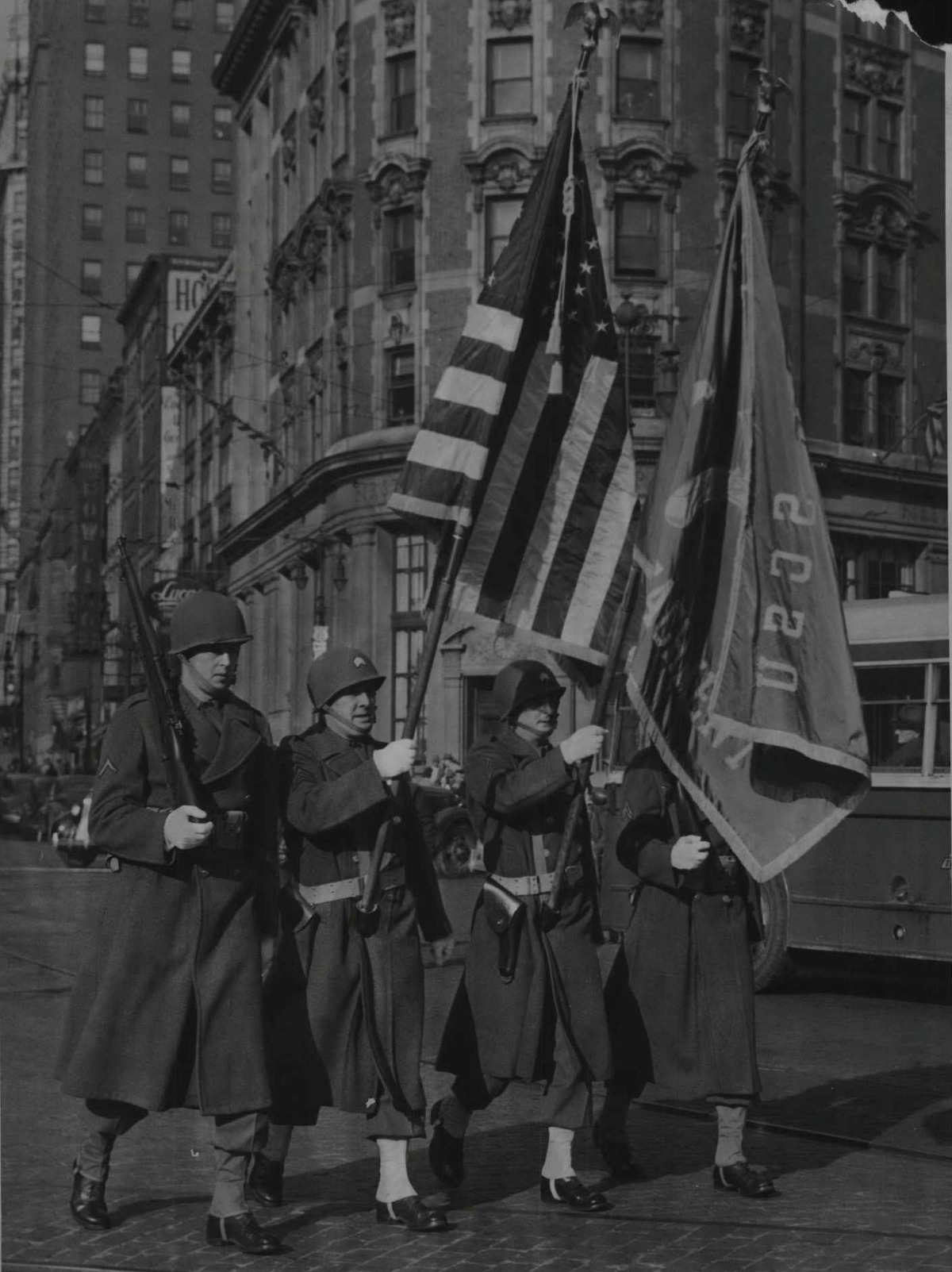 Military police color guard lead the way as Albany's Pearl Harbor Day Parade starts out from the Plaza. The parade signaled the opening of an American Legion War Bond show in the Ten Eyck Hotel, Albany, New York. December 8, 1944 (Times Union Archive)