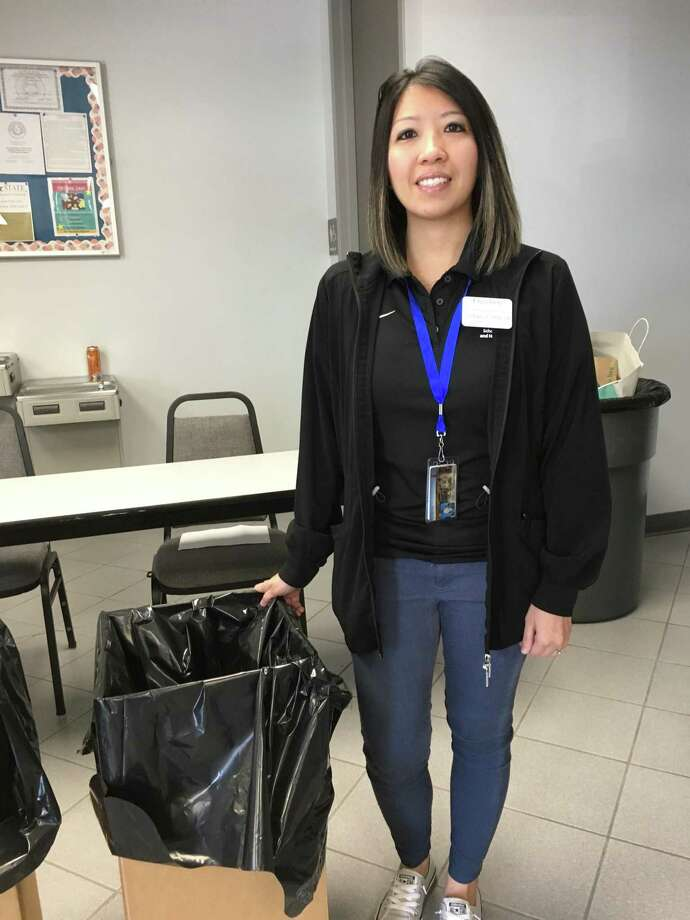 The Katy ISD Police Department was a popular place mid-morning Saturday as people dropped off plastic bags filled with unused or expired prescription drugs. Among those helping was Creighton University pharmacy student Thanh Fornesa. She said she also helped in the spring as part of the Drug Take Back program, which drew many participants. Photo: Karen Zurawski / Karen Zurawski
