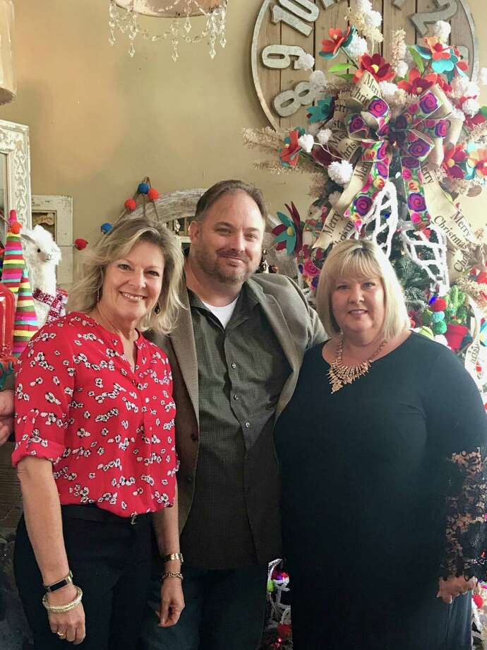 Pictured from left are Kathy Alt, executive director of The Ballard House, with Festival of Trees show producers Brian Varvel and Christy Bohlen of Keller Williams Premier Realty. Photo: Courtesy Photo