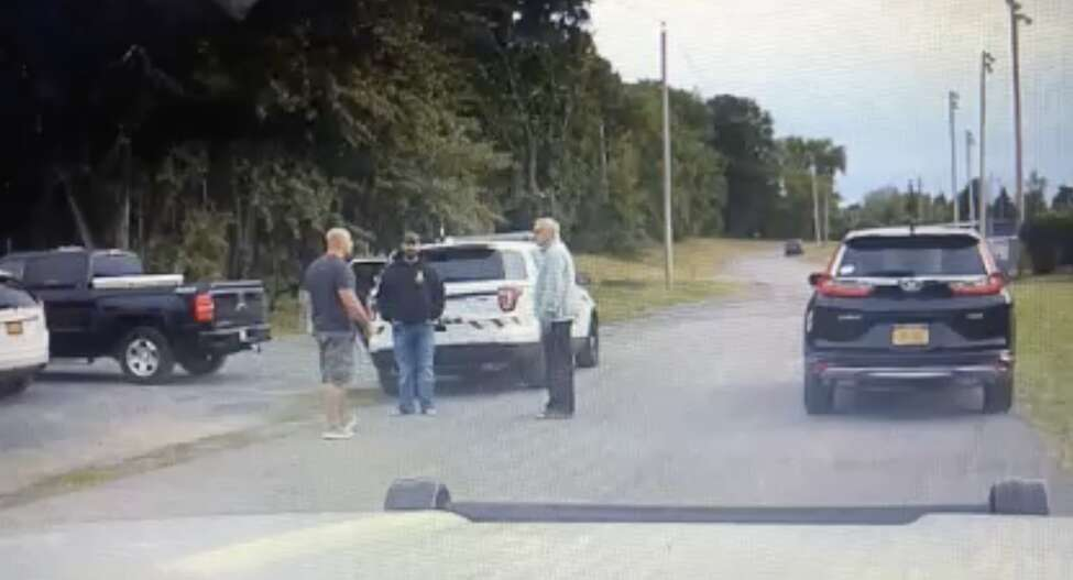 North Greenbush police respond to reports of a fight involving Troy Police Officer Dominick Comitale on Sept. 8, 2018, at a town Little League field. Comitale is the man in gray shorts, a navy shirt and sneakers.
