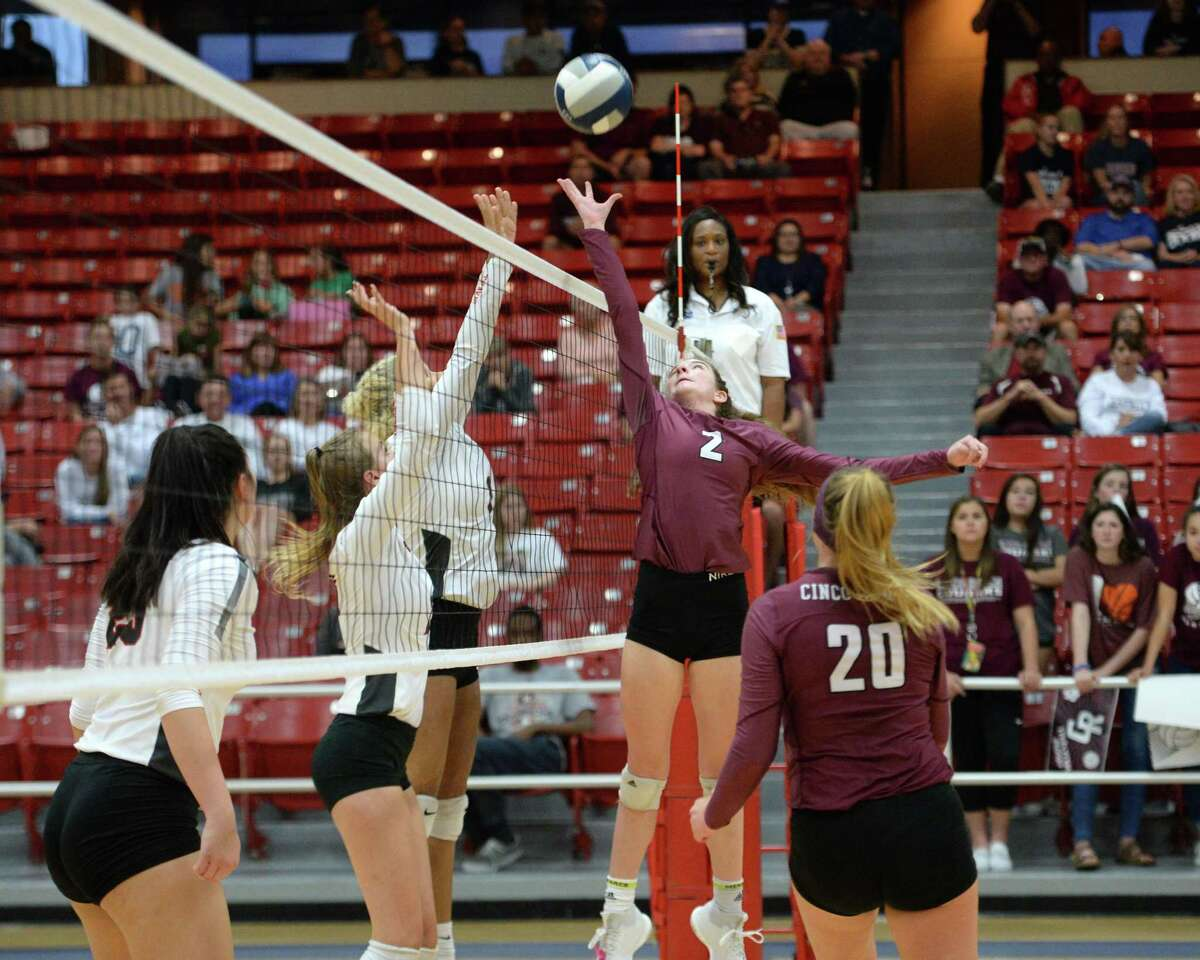 Eva Fitzgerald (2) of Cinco Ranch tips a ball over the net in the third set of a bi-district playoff volleyball match between the Cinco Ranch Cougars and the Travis Tigers on October 30, 2018 at Wheeler Fieldhouse, Sugar Land, TX.