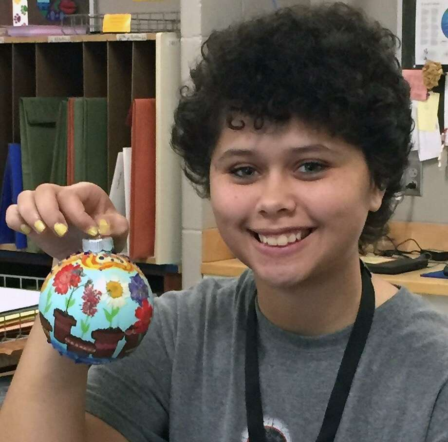 Cypress Creek High School junior Sierah Haines holds the ornament she designed and created that was chosen to represent Texas District 126 and Rep. Kevin Roberts on the 2018 Christmas tree at the State Capitol. It will be on display from Nov. 29 to Jan. 2. Photo: CFISD / CFISD