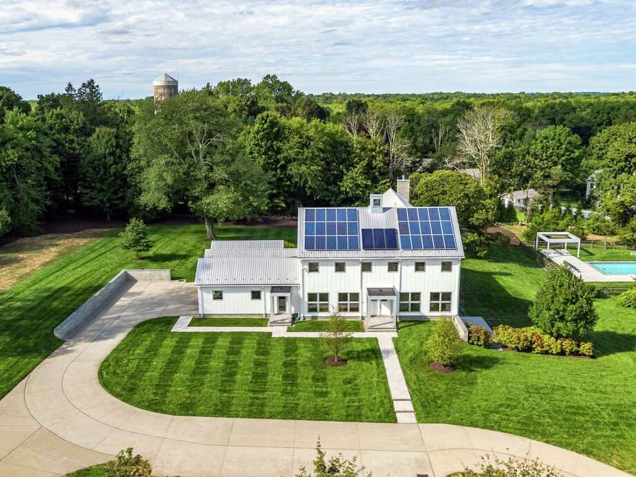 From its outward appearance the contemporary colonial house 19 Pembroke Road resembles a modern day farmhouse, its solar panels on the roof seemingly a deliberate design element.