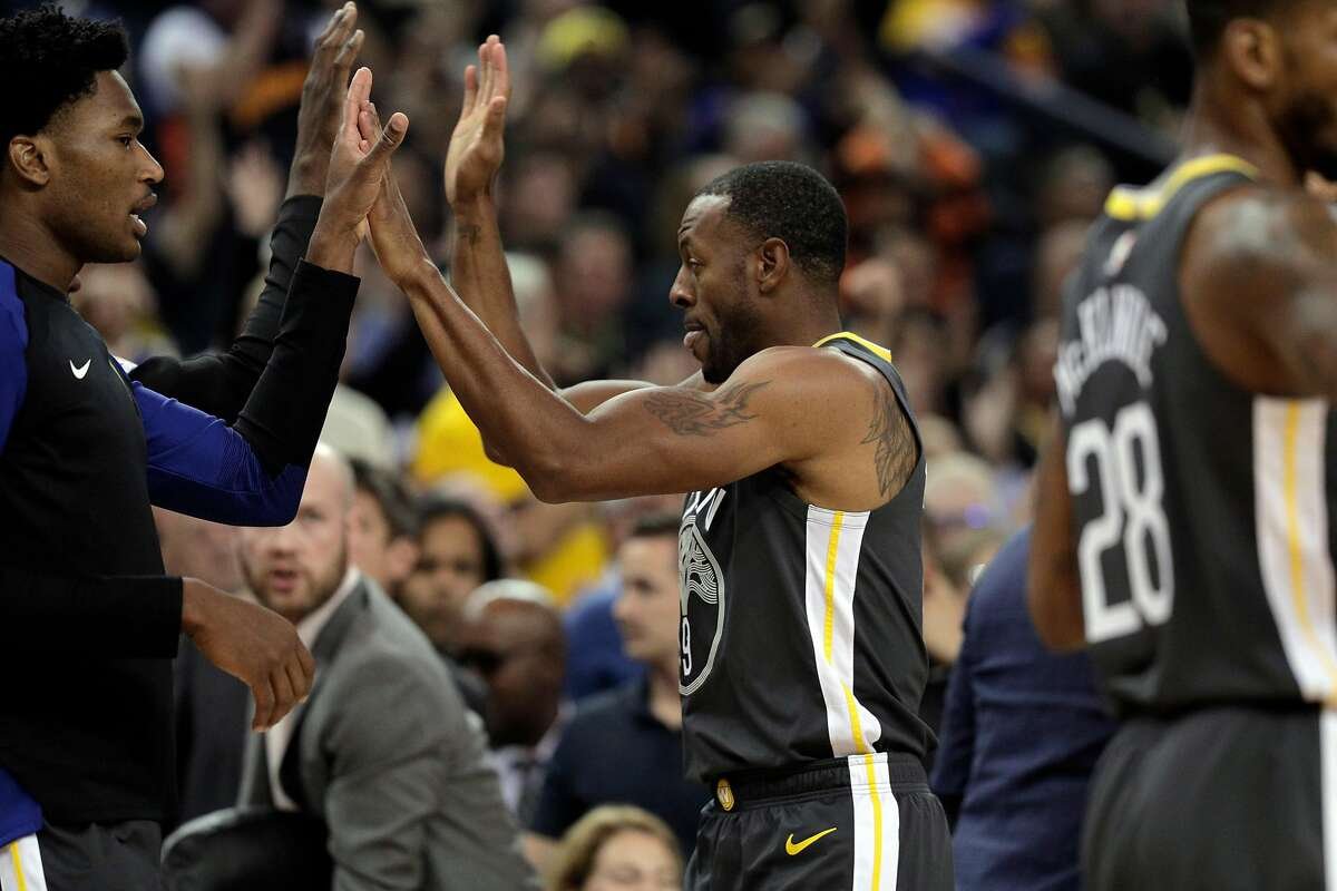 Andre Iguodala (9) gets high fives after hitting a buzzer beater to end the first quarter as the Golden State Warriors played the New Orleans Pelicans at Oracle Arena in Oakland, Calif., on Wednesday, October 31, 2018.