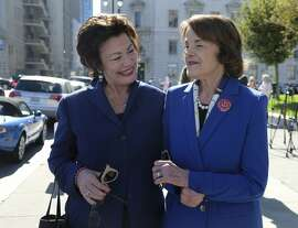 U.S. Sen. Dianne Feinstein smiles and walks with former Congresswoman Ellen Tauscher, left, after dropping off her vote-by-mail ballot outside City Hall Monday, Nov. 5, 2018, in San Francisco. Feinstein, who is seeking her fifth full term in the Senate, is being challenged by fellow Democrat, state Sen. Kevin de Leon. (AP Photo/Eric Risberg)