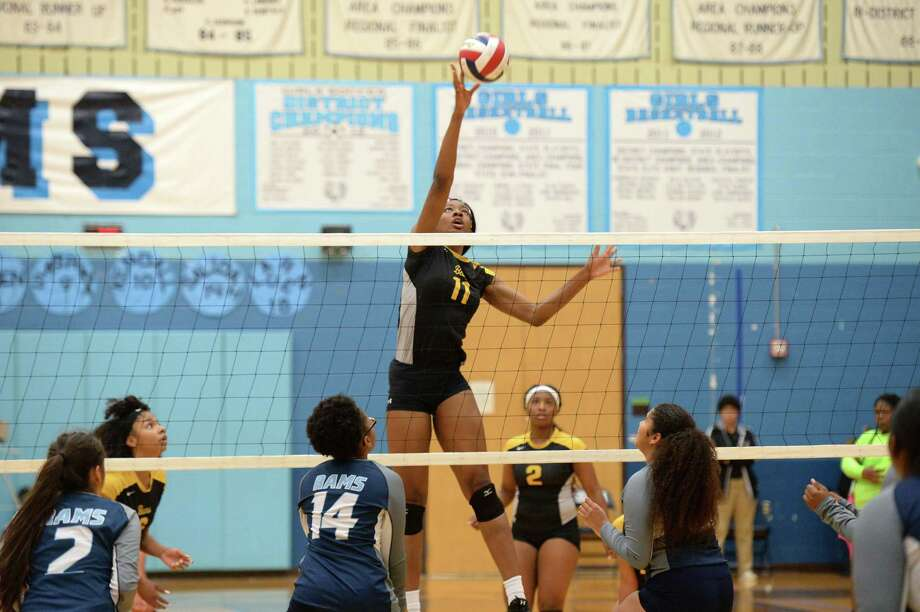 Anita Anwusi (11) of Hastings attempts a kill shot in the second set of a high school volleyball match between the Elsik Rams and the Hastings Bears on Oct. 2, at Elsik HS, Alief. Photo: Craig Moseley, Staff / Staff Photographer / ©2018 Houston Chronicle