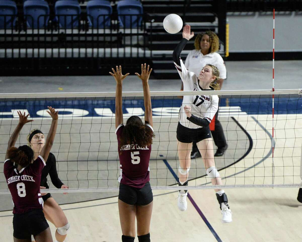 Avery Shimaitis (17) of George Ranch attempts a kill shot in the third set of a Class 6A Region III Area-round playoff volleyball match between the George Ranch Longhorns vs Summer Creek Bulldogs on Friday, November 2, 2018 at Delmar Fieldhouse, Houston, TX.