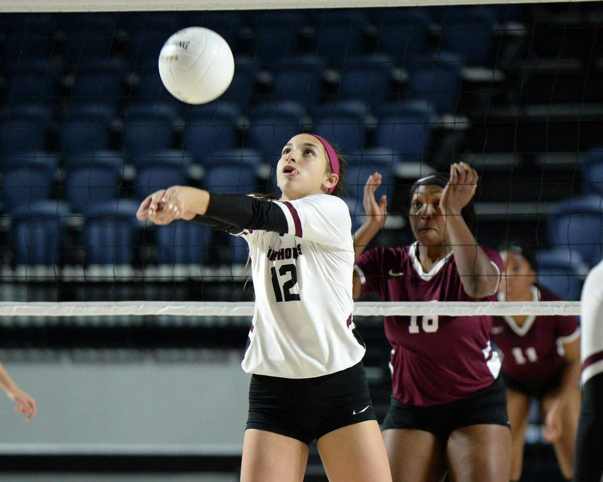 Logan Lednicky (12) of George Ranch digs for a ball in the second set of a Class 6A Region III Area-round playoff volleyball match between the George Ranch Longhorns vs Summer Creek Bulldogs on Friday, November 2, 2018 at Delmar Fieldhouse, Houston, TX.