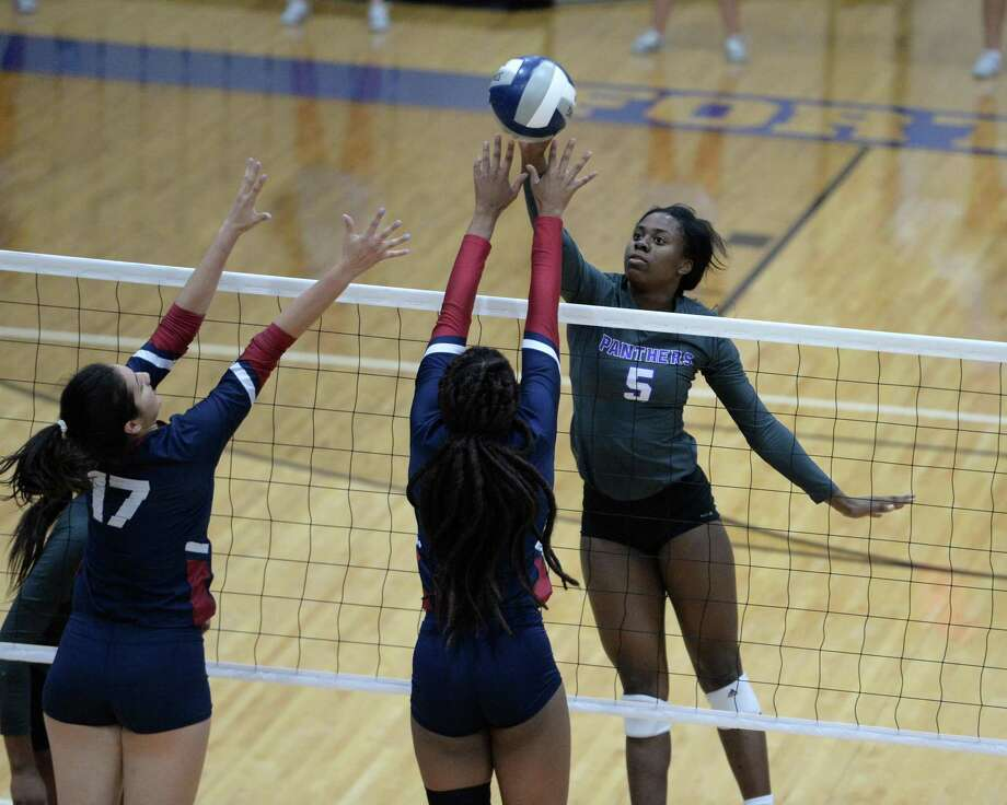 Tiana Davis (5) of Ridge Point hits a shot in the first set of a bi-district playoff volleyball match between the Ridge Point Panthers and the Tompkins Falcons on Oct. 30, at Wheeler Fieldhouse in Sugar Land. Photo: Craig Moseley, Staff / Staff Photographer / ©2018 Houston Chronicle