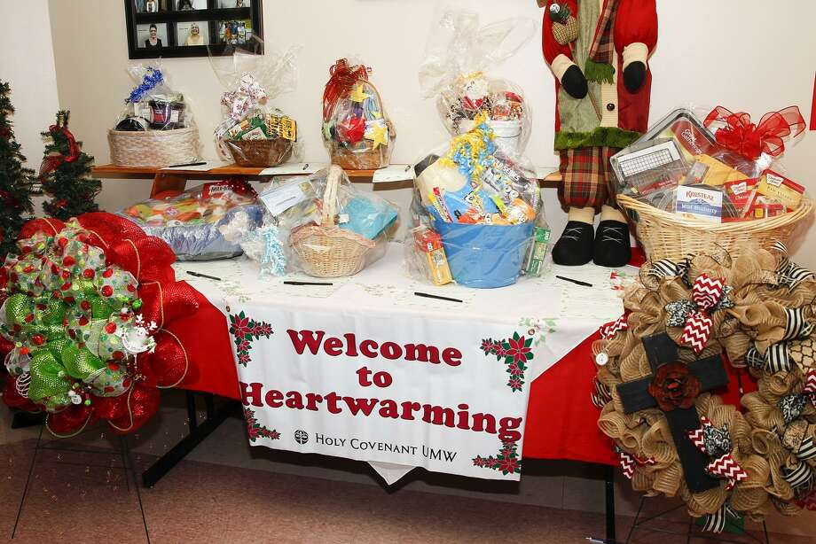 Holy Covenant United Methodist Church, 22111 Morton Ranch Road, Katy, will host its Heartwarming Christmas Craft Show from 9 a.m.-4 p.m. Saturday, Nov. 10. The show features The Sweet Shoppe, Sandwich Shopper, a silent auction and free Santa photos. Theme-inspired baskets and wreaths line one of the silent auction tables at the 26th annual Heartwarming Christmas. Photo: Diana L. Porter, Freelance / For The Chronicle / © Diana L. Porter