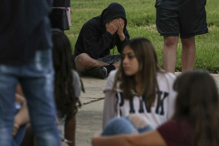 Alessandro Sosa holds his head in his hands as he sits at a makeshift memorial outside the home where sisters Isabella Perez, 15, Maria Perez, 14, and their step father, Victor Portillo, were all found shot to death Sunday, Nov. 4, 2018, in Katy. Photo: Michael Ciaglo, Houston Chronicle / Staff Photographer / Michael Ciaglo
